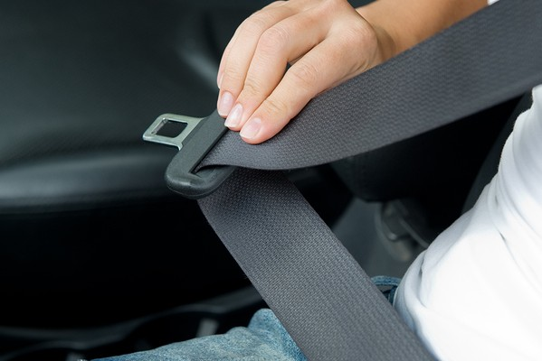 Fastening the seat belt