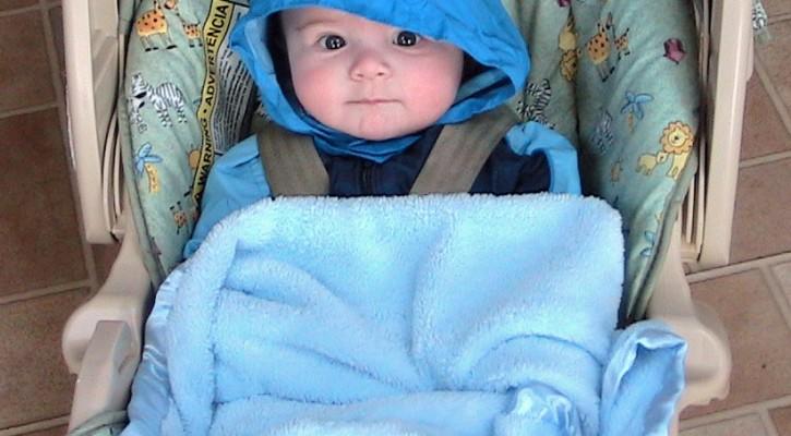 Baby Bundled In Bulky Winter Coat